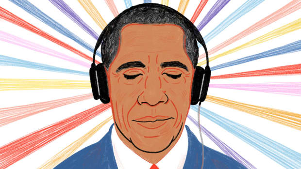 President Obama listening to music under headphones.