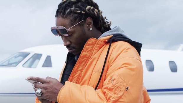Future, looking at phone
