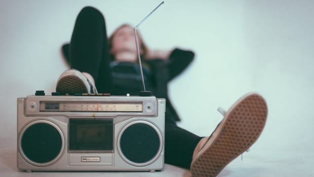 Man lying on the floor, listening to the radio