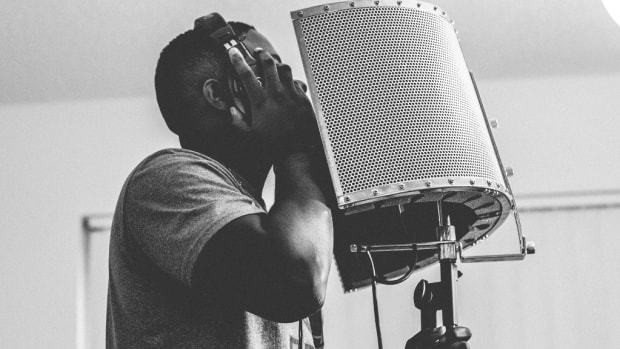 man-performing-microphone-tunecore-story