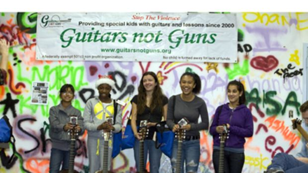 guitarsguns.jpg