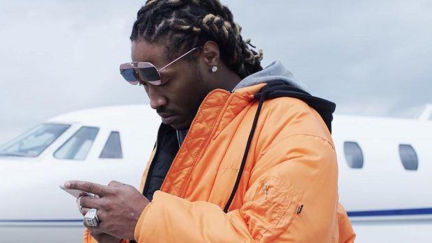 Future, looking at phone