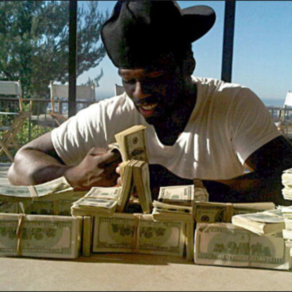 [Image: 50-cent-sitting-with-money-stacksjpg.jpg]