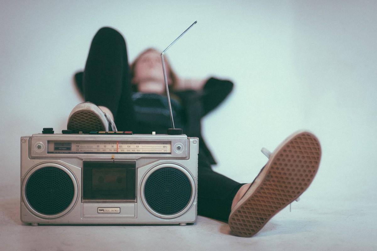 Man lying on the floor, listening to the radio
