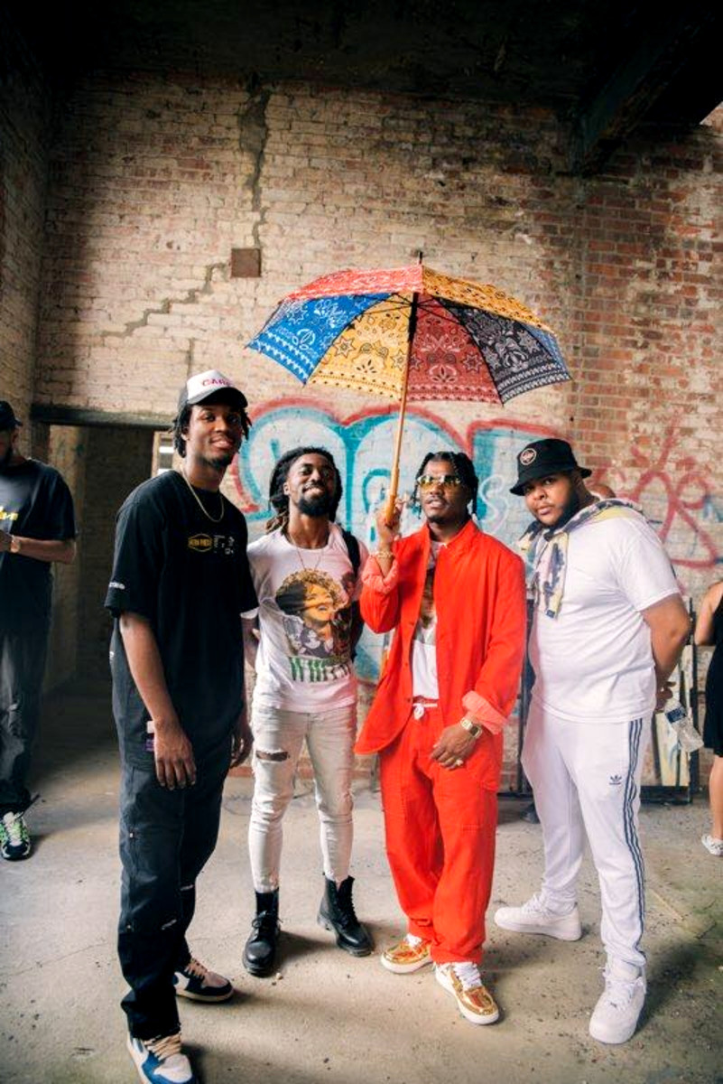 "Left to right: Saba, Olu, Smino, and Groove, on the set of the ""Sacrifices"" video shoot."