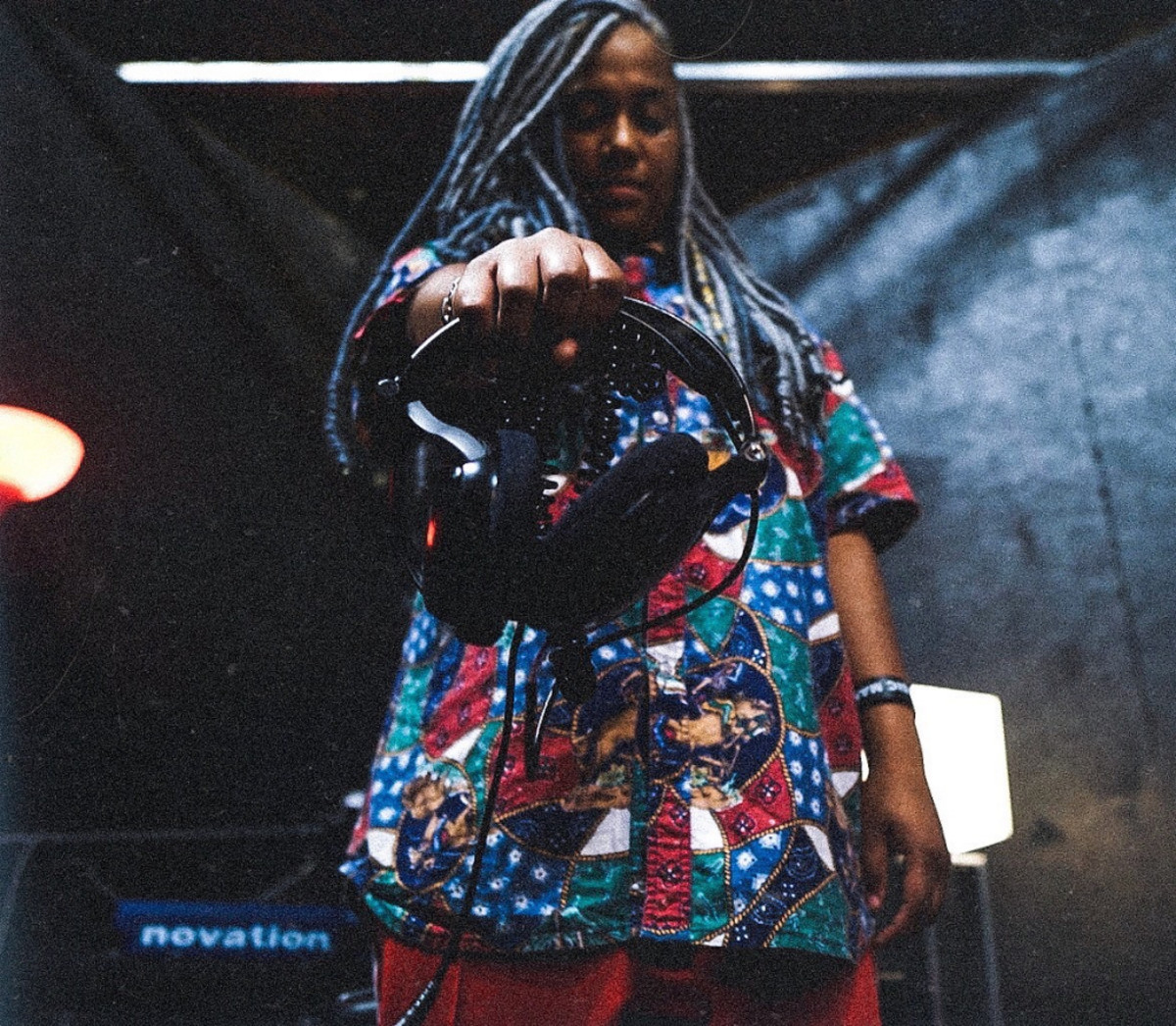 woman holding headphones