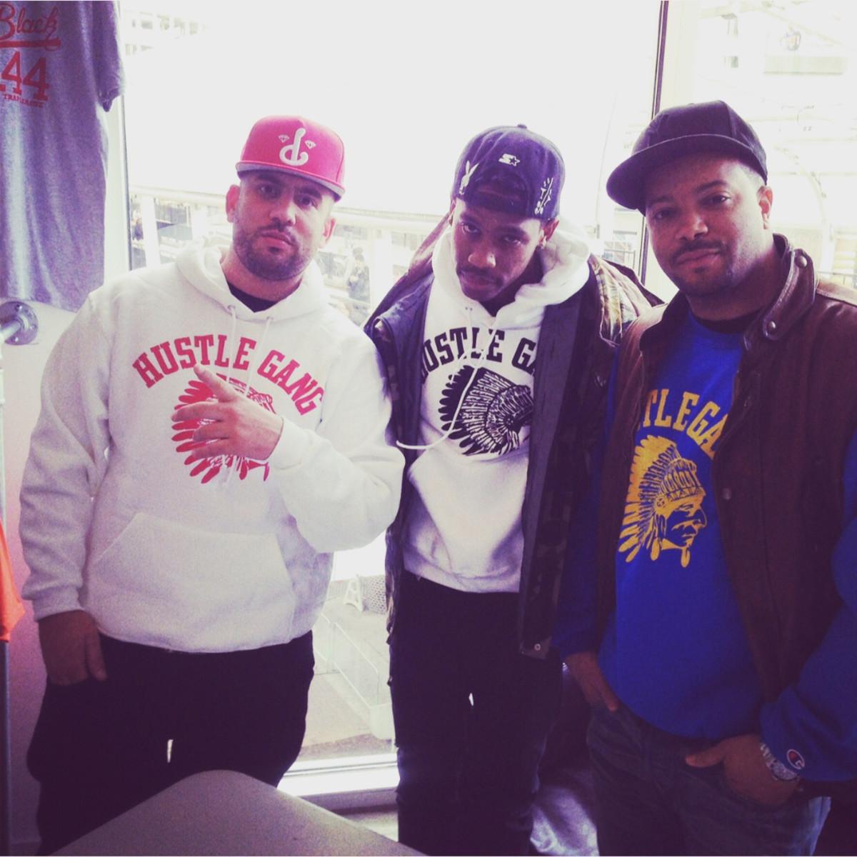 DJ Drama, Travis Scott, and Jason Geter (R).