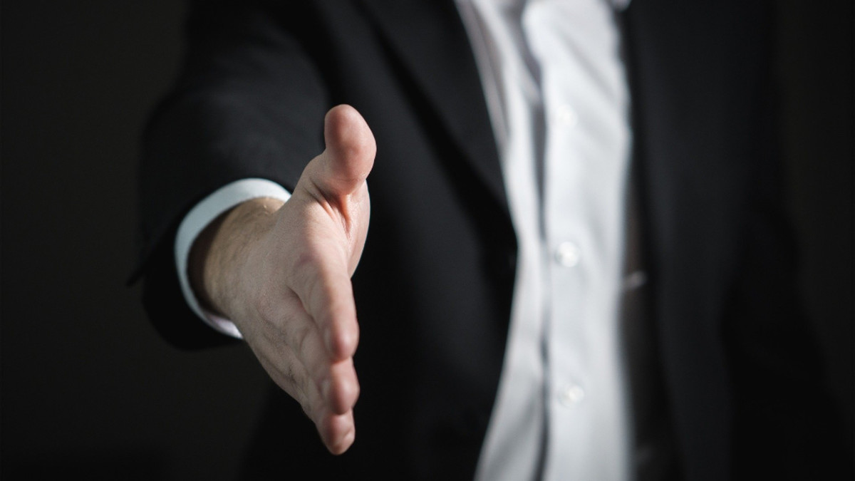 white-man-handshake
